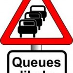 Traffic queues likely and motorcyle overtaking
